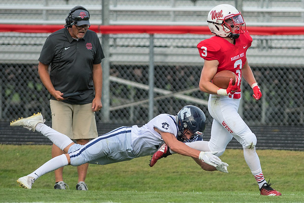 Rochester Century's Isaiah Huber makes a touchdown-saving tackle on Jon Sikel of Mankato West after a successful screen pass during Friday's home opener for the Scarlets. West won the game 24-0. Photo by Jackson Forderer