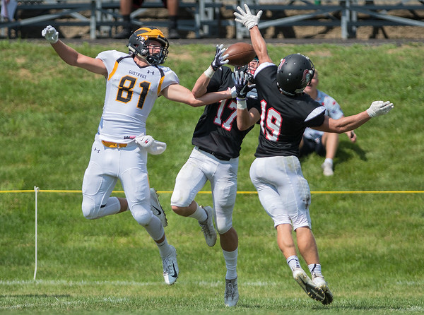 Martin Luther College's Joe Herrewig (19) and Jared Witkowiak (17) break up a pass intended for Gustavus wide receiver Josh Kirk (81) during Saturday's game played in New Ulm. Photo by Jackson Forderer