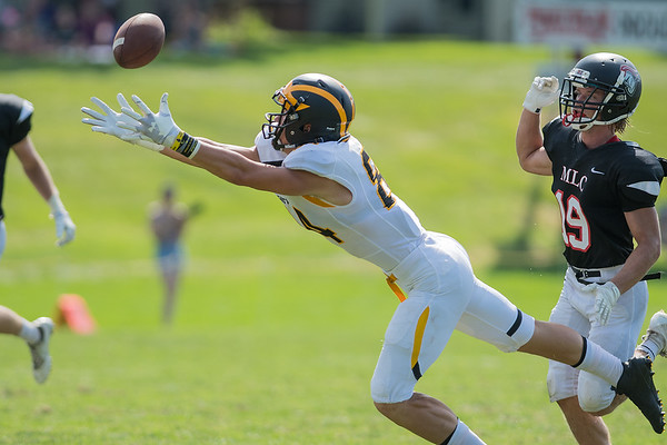Gustavus' Ellis Hirman stretches out for a pass from quarterback Michael Veldman during Saturday's game against Martin Luther College. At times, the Gustie offense sputtered against the Knights, but they pulled out a 32-20 win. Photo by Jackson Forderer