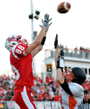 Mankato West's Scott McKissick catches a touchdown pass over Winona's Chris Wermuth during the first half Friday at Todnem Field.
