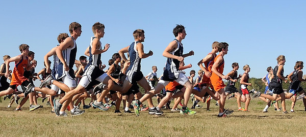 Teams take off from the start line during the boys varsity race Friday on the Loyola campus.