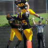 Gustavus Adolphus College's Michael Hintze (80) celebrates a first half touchdown catch with teammates Kyle Sonneburg (15) and Jeff Dubose (41) Saturday.