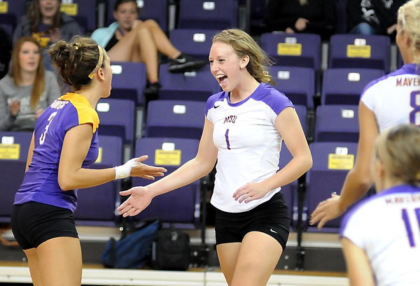 Minnesota State's Chelsea Fogarty (1) celebrates a point with teamate Kelli Elhardt during their match against Concordia-St. Paul Tuesday at Bresnan Arena. Fogarty led the Mavericks with 20 kills in their upset of the No. 2-ranked Golden Bears.