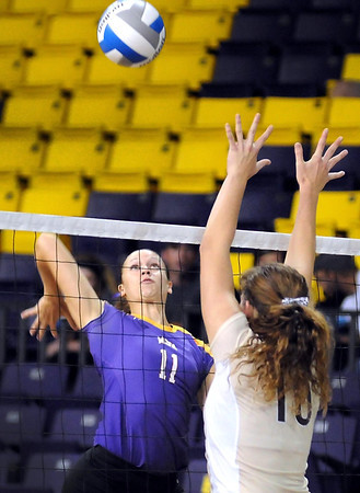Minnesota State University's Kayla Berning winds up to hit the ball past Southwest Minnestoa State's Mary Groth during their match Saturday at Bresnan Arena.