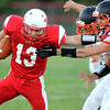 Mankato West's Alex Knutson tries to escape a pair of Winona defenders during the first half Friday.