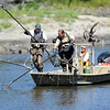 Workers from the DNR's Ortonville Fisheries Office use electrical current emitted from electrodes dangling in the water to capture fish for a survey of fish populations in the Minnesota River near Redwood falls.