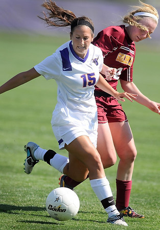 Minnesota State's Kristina Gelecki and University of Minnesota, Crookston's Delaney McIntyre battle for the ball during their match Saturday.