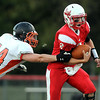 Mankato West quarterback Ryan Schlichte tries to elude the tackle of Winona's Dan Schwartz during the first half Friday.