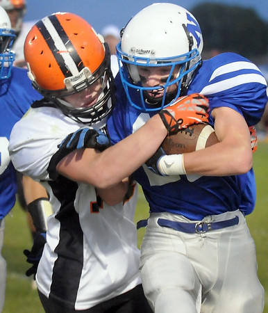 Pat Christman <br /> Cleveland's Spencer Davies, left, wraps up Nicollet's Kenny Fisher during the first half Friday in Nicollet.