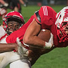Dandre Spann (right) of Mankato West drags Rochester John Marshall's Quin'Dariean Hardy with him into the end zone during Friday's game played at West. West shutout John Marshall 35-0 on their way to a 41-0 victory. Photo by Jackson Forderer