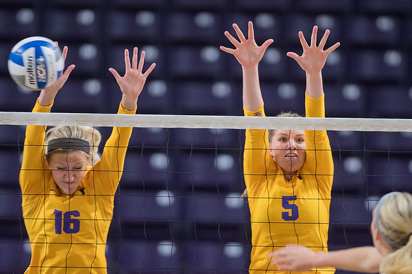 Minnesota State's Anissa Janzig (16) and Alivia Garbe (5) successfully block a spike from a Winona State player during Thursday's game played at Bresnan Arena. The Mavericks lost 3-0 to Winona State. Photo by Jackson Forderer