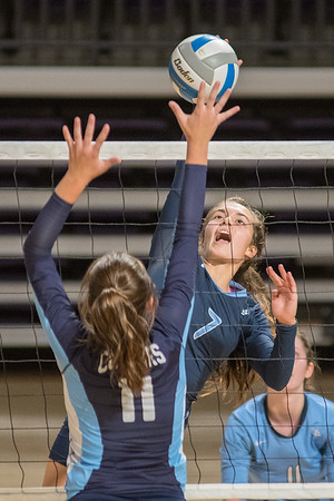 Minnesota Valley Lutheran's Emma Nelson (7) spikes the ball as Cedar Mountain Comfrey's Mackenzie Kerkhoff (11) attempts a block in the fifth-place match at the Mankato West Volleyball Invite. MVL took sixth place in the tournament. Photo by Jackson Forderer