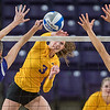 Minnesota State's Sydney Powell (3) splits two Winona State defenders, Maria Wrage (5) and Maria Freuchte (right) with a spike in the third game played at Bresnan Arena on Thursday. The Mavericks fell in three straight games to the No. 11 ranked Winona State team. Photo by Jackson Forderer