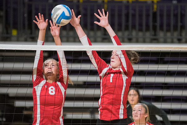 Mankato West's Lauren Marzolf (8) and Ellie Blackman (1) make a block on a Mayer Lutheran player's spike in the championship game of the West Volleyball Invite. West took second place in the tournament and Mayer Lutheran took first. Photo by Jackson Forderer