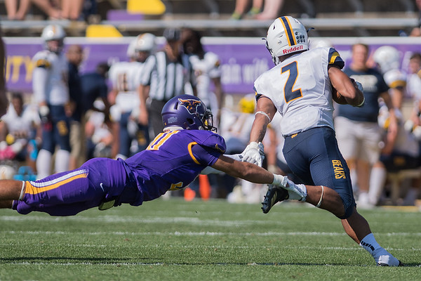 Cade Johnson of Minnesota State dives at the feet of Shaq Johnson of Concordia-St. Paul during the second half of Saturday's game. Photo by Jackson Forderer