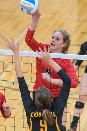 Bethany Lutheran's Mindy Poehler tips the ball past Morgan Miller of University-Morris during Tuesday evening's game. The Vikings lost the match 3-1. Photo by Jackson Forderer