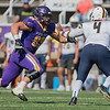 Minnesota State's Brayden Thomas chases down quarterback Dom McKinzy (4) of Concordia-St. Paul during Saturday's game at Blakeslee Stadium. McKinzy got away on the play, but the MSU defense held Concordia to 13 points and scored two safeties. Photo by Jackson Forderer