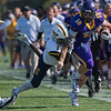 Minnesota State freshman quarterback Brevin Kaiser is forced out of bounds by Concordia-St. Paul's Marcus Haskins in the second half of Saturday's game played at Blakeslee Stadium. MSU won the game 46-13. Photo by Jackson Forderer