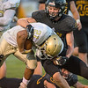 Mankato East's Jacob Prybylla tackles Rochester Mayo's Israel Lozoya during Friday's game. Lozoya rushed 21 times for 285 yards. Photo by Jackson Forderer