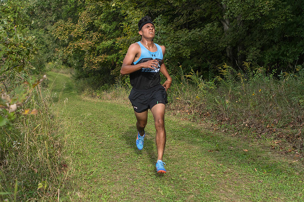 Hugo Ruiz of Tri-City United runs on the trail at Mankato Loyola during Friday's cross country meet. Ruiz was the boys medalist with a time of 16:36. Photo by Jackson Forderer