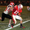 Mankato West's Alex Knuston is shoved out of bounds by Rochester John Marshall's Alex Brady during West's last possession of the game Friday at Todnem Field.