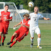 East's Ben Schwartz and West's Dillion Lambert collide while going for the ball as West's Matthew Leitch looks on.