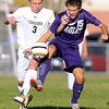 Mankato East's Ben Schwartz and Rochester Lourdes' Matt Kempinger chase after the ball during the first half Thursday.