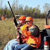 John Cross<br /> Steven Dunham of New Ulm (left) and Dave DeGonda of New Market team up to hunt pheasants Saturday at a special hunt for disbled veterans at the River Ridge Gun Club near Courtland. Piloting the ATV is Greg Peterson of Brown County Veterans Affairs.