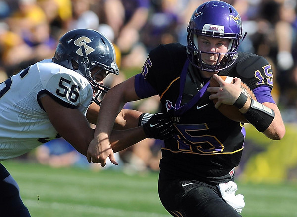 Minnesota State quarterback Mitch Brozovich is chased by Concordia's Brock Molden during the first half Saturday.