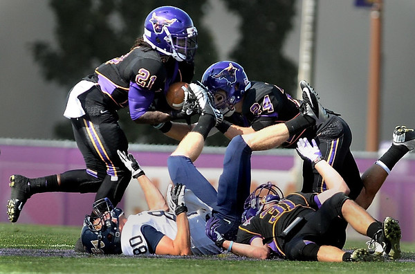 Minnesota State University's Earl Brooks (21) intercepts a pass intended for Concordia receiver Dustin Christen (80) during the first half Saturday at Blakeslee Stadium.
