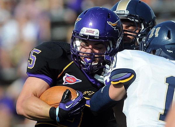 Minnesota State University running back Connor Thomas struggles for extra yards near the goal line during the first half Saturday.