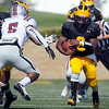 Gustavus Adolphus College quarterback Muresuk Mena finds some running room during the first half Saturday in St. Peter.