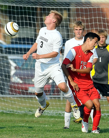 East's Ben Schwartz and West's William Leitch mix it up in front of the East goal.