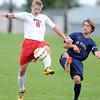 Pat Christman <br /> Mankato West's Paul Esslinger (8) beats St. Peter's Kaelan Weiss (6) to the ball during the first half Saturday at the Dakota Meadows field.