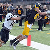 Pat Christman <br /> Gustavus Adolphus College's Matt Boyce keeps his feet in bounds as he pulls in a touchdown catch during the second half of their game against St. Olaf College Saturday at Hollingsworth Field.
