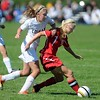 Pat Christman <br /> Mankato East's Danielle Joyal tries to get around Mankato West's McKenna Peters during the second half Saturday.