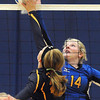 Pat Christman <br /> Mankato Loyola's Lindsay Solheid (14) and Truman's Savannah Hodge reach for the ball at the net during their match Thursday at the Fitzgerald gym.