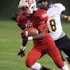 Pat Christman <br /> Mankato West running back Cory Johnson outruns Mankato East's Mitch Strand during the first half Friday at Blakeslee Stadium.