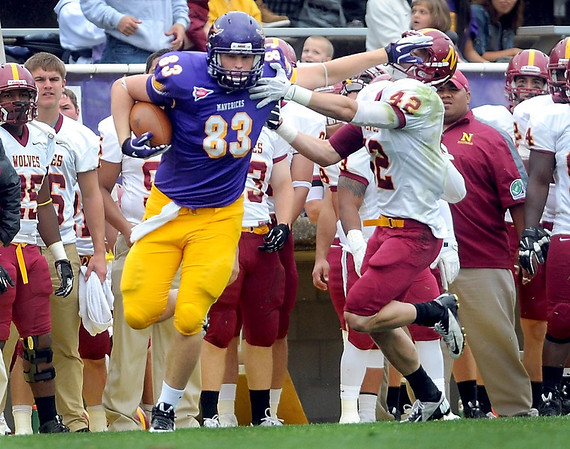 Pat Christman <br /> Minnesota State's Bryce Duncan shoves Northern State's Mike Tuch during the first half Saturday.