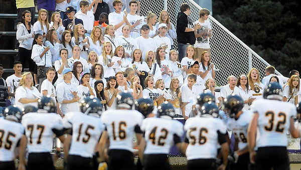 Pat Christman <br /> Mankato East fans cheer as their football team is introduced prior to their game against Mankato West Friday at Blakeslee Stadium.