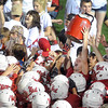 Pat Christman <br /> Injured Mankato West receiver Will Claussen holds up the Kato Jug after the Scarlets' win over crosstown rival Mankato West 55-0 Friday at Blakeslee Stadium.