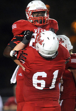 Pat Christman <br /> Mankato West running back Cory Johnson celebrates a touchdown run with teammate Josh Wold during the first half against crosstown rival Mankato East Friday at Blakeslee Stadium.