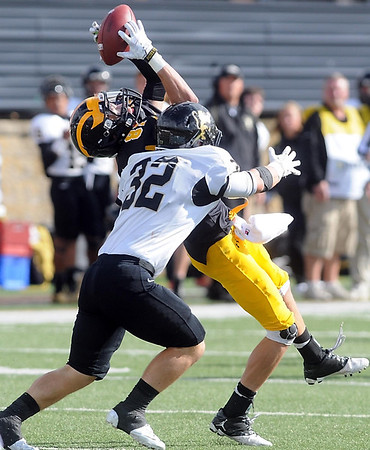 Pat Christman <br /> Gustavus Adolphus receiver Matt Boyce hangs on to a pass as he is hit by St. Olaf's Tyler Vajdic during the second half Saturday.
