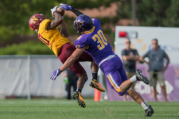 Northern State's Zech Culbreath makes a leaping catch despite Minnesota State's Cade Johnson (30) defensive efforts. The Mavericks blanked Northern State 31-0 on Saturday. Photo by Jackson Forderer