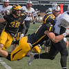 Casey Decker of Gustavus sacks Hamline's quarterback Justice Spriggs in the second half of Saturday's game. Gustavus won a lopsided game 51-7. Photo by Jackson Forderer