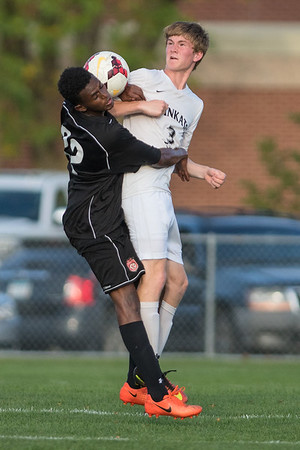 Mankato East's Spencer Claude (3) and Rochester John Marshall's Mohamed Mohamed collide while going for a header. The Cougars tacked on two goals late in the second half to pull away for a 5-1 victory. Photo by Jackson Forderer