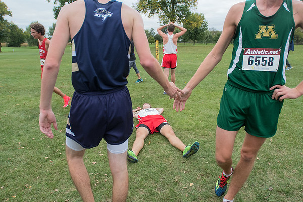 Mankato West's Carter Deichman (left) and other runners cool down after running 5,000 meters at the West Cross Country Invitational. Photo by Jackson Forderer