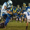 Mankato Loyola's Ben Ellingworth tries to break free from a foot hold while Nicollet's Jon Mans (12) tries to make the tackle on Ellingworth. Photo by Jackson Forderer