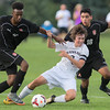 Mankato East's Colin Knutson fights for control of the ball against Rochester John Marshall's Hassan Nuh (left) and Carlos Garcia (18) during Thursday's match. East won the game 5-1. Photo by Jackson Forderer