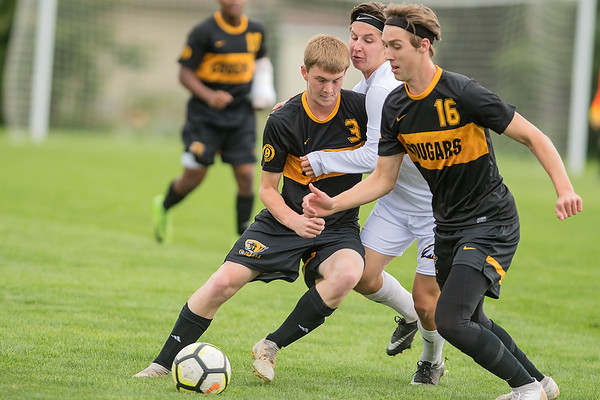 Mankato East's Spencer Claude (3) clashes with Rochester Lourdes' Colton Praska in a highly-contested match played on Thursday. East won the contest 2-0. Photo by Jackson Forderer